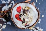 Coconut Smoothie Bowl in a halved coconut shell.