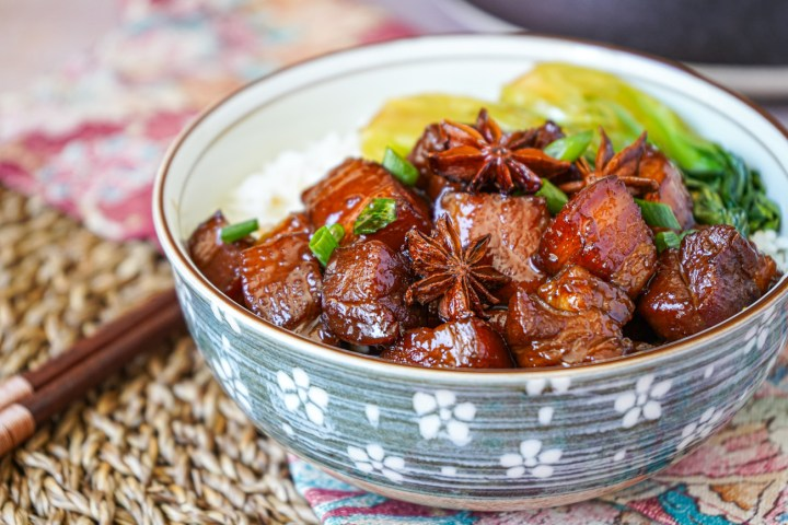 Hong Shao Rou (Chinese Red-Braised Pork Belly) in a bowl with rice and Bok Choy.