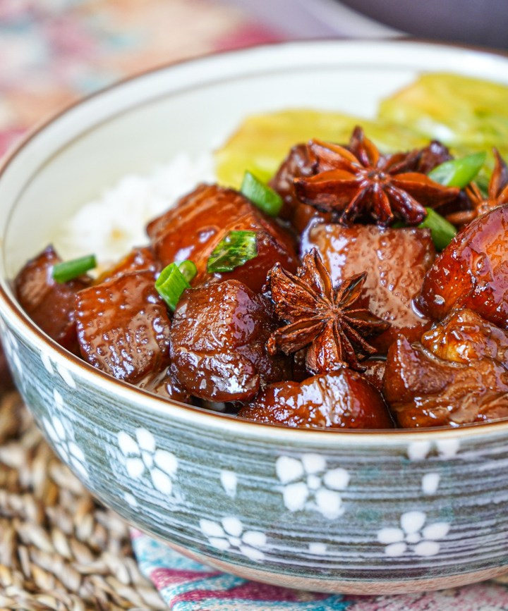 Hong Shao Rou (Chinese Red-Braised Pork Belly in a bowl with rice and Bok Choy.