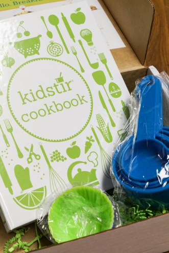 Kidstir Cookbook Binder, Measuring Cups, and Silicone Cups.