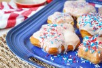 Star-Shaped Doughnuts on a blue platter with red, white and blue sprinkles.