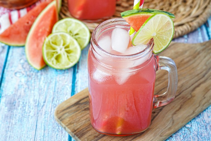 Agua de Sandía (Mexican Watermelon Water) in a glass mug with watermelon and lime.