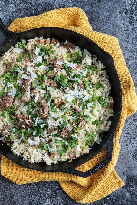 Arroz Carreteiro (Brazilian Wagoners' Rice) topped with parsley and parmesan