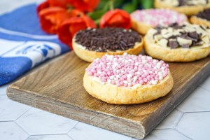 Beschuit (Dutch Rusk) topped with pink sprinkles and chocolate sprinkles.