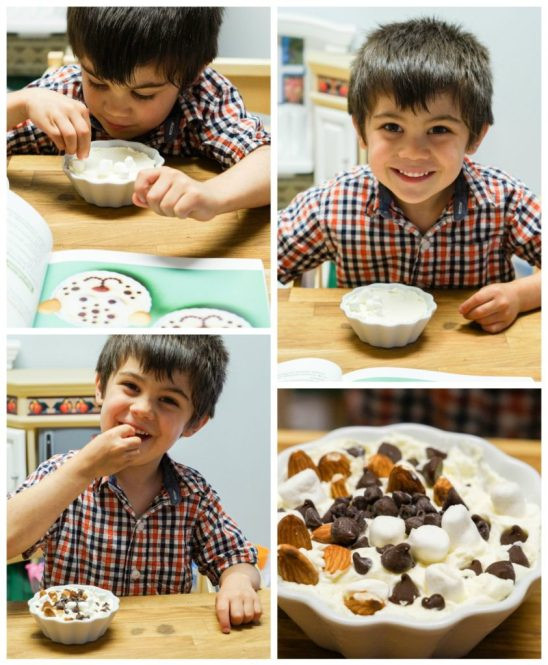 Boy piling the Cheetah Cheesecake with lots of marshmallows and chocolate chips.
