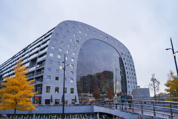 Markthal in Rotterdam- large arch building with glass entrance and apartments along the side