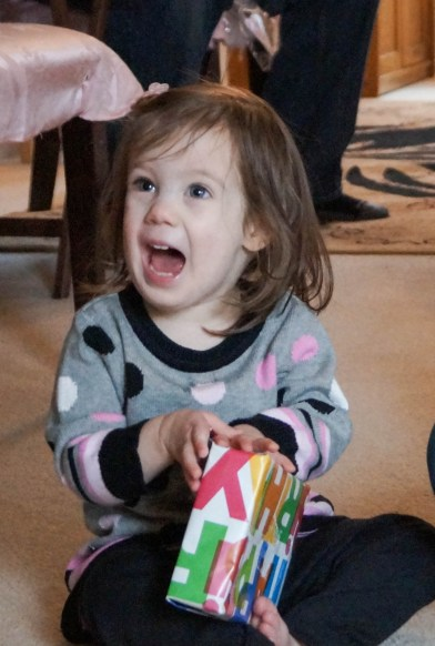 Little girl holding a present.