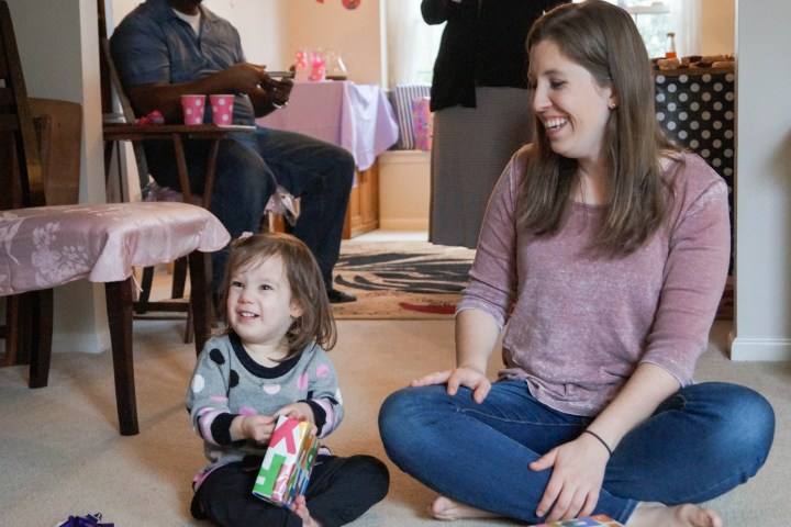 Mom and daughter sitting on floor.