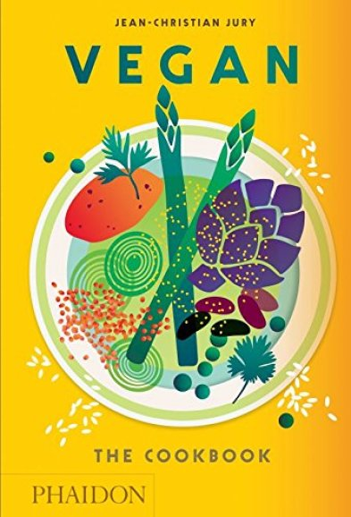 Bright yellow cookbook cover with illustrations of asparagus, lentils, artichoke, peas, sweet potato and herbs- Vegan: The Cookbook by Jean-Christian Jury.