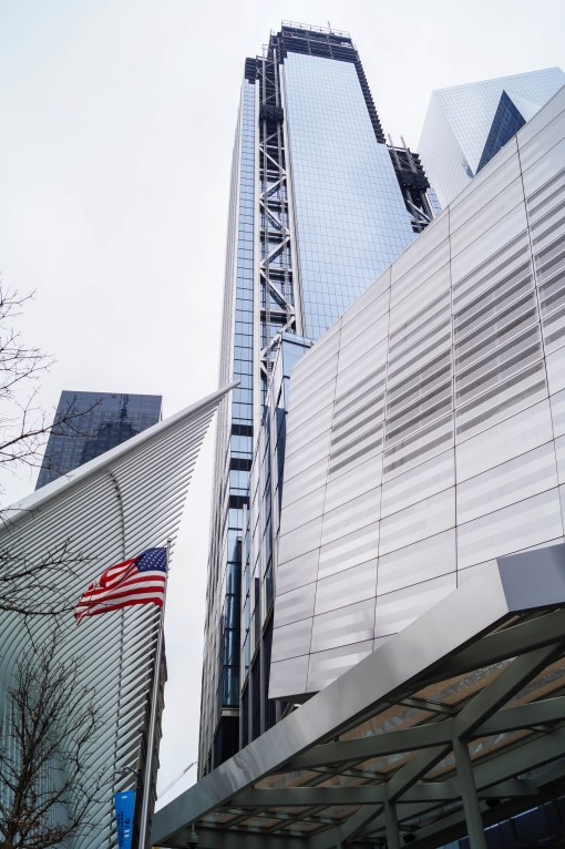 Entrance to the 9/11 Memorial & Museum with an American flag.