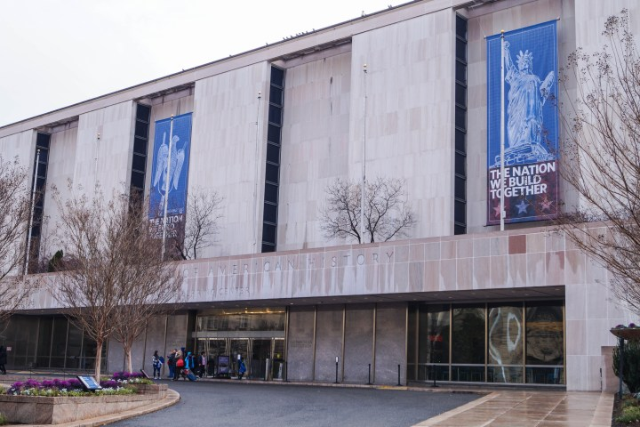 Entrance to Smithsonian National Museum of American History with banner of the Statue of Liberty: The Nation We Build Together