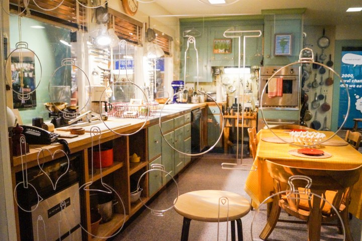 Julia Child's Cambridge, Massachusetts kitchen with dining table, cabinets, and oven built into the wall.