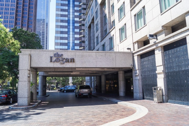 Car pulling into the entrance of The Logan Hotel.