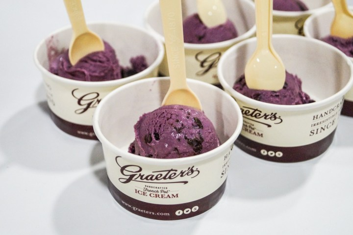Scoops of purple ice cream in paper cups at Graeter's Ice Cream.