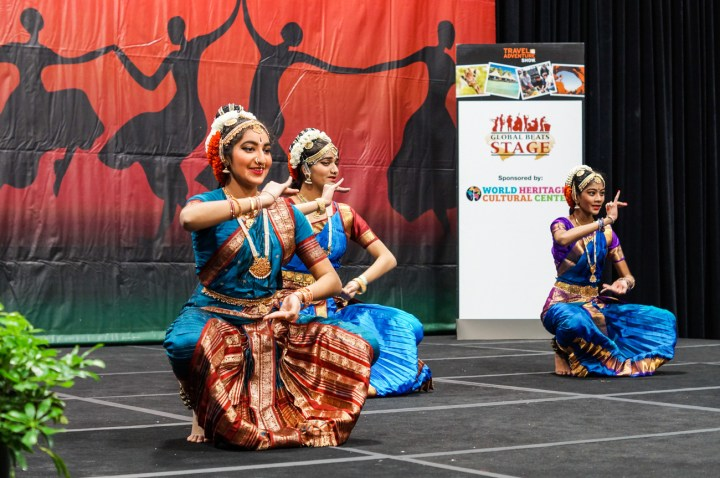 Pranava Natyam School of Kuchipudi dancers in blue and red costumes