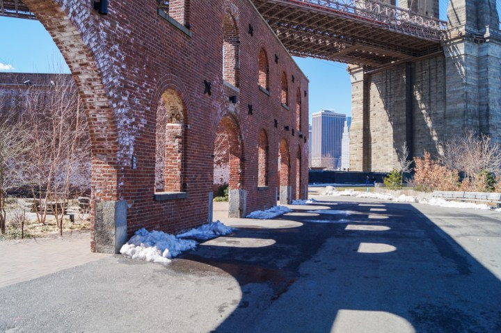 Brick building with shadow on the concrete.