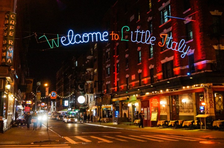 Sign of Little Italy over a street.