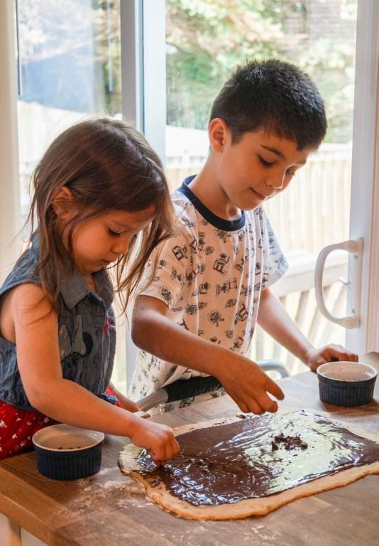 Sprinkling chocolate chips over the Chocolate Babka dough.