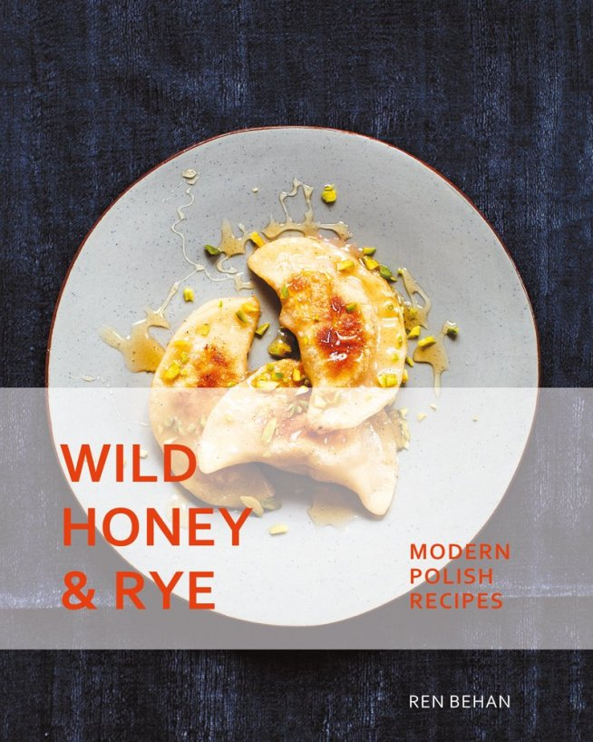 Cookbook cover with Pierogi on a white plate with a drizzle of honey- Wild Honey & Rye: Modern Polish Recipes by Ren Behan