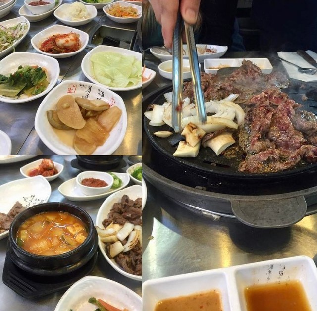 Spread of banchan in white bowls and grilling meat at Kogiya Korean BBQ.