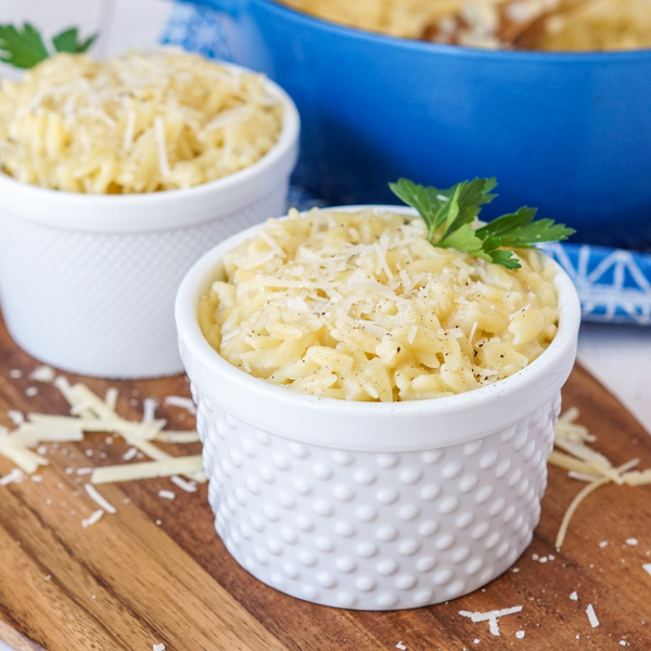 Cheesy Orzo in a bowl with fresh parsley