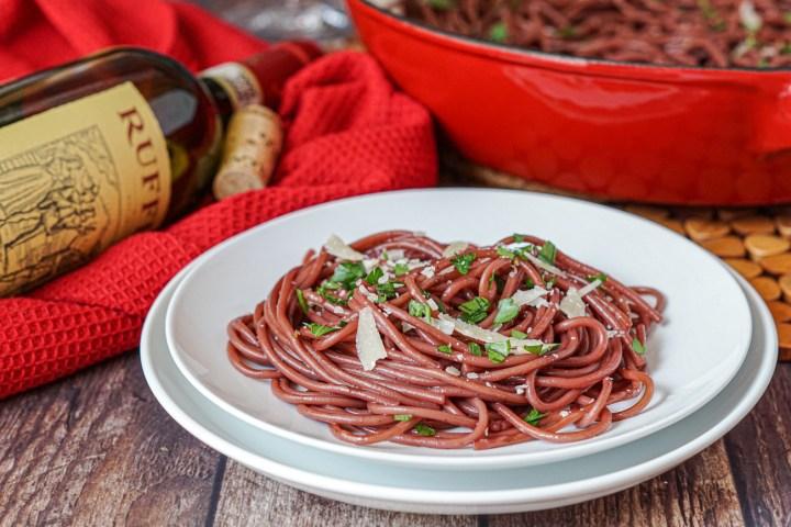 Spaghetti All'Ubriaco (Drunken Spaghetti) on a stack of two white plates.