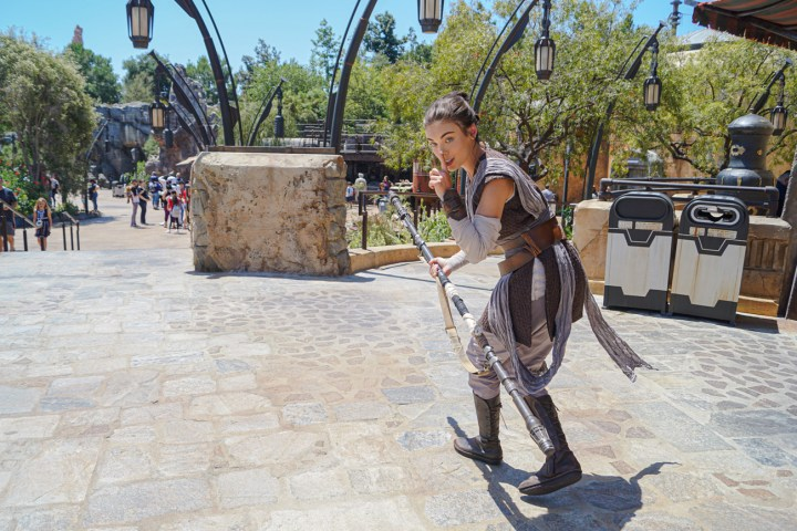 Rey walking outside at Galaxy's Edge