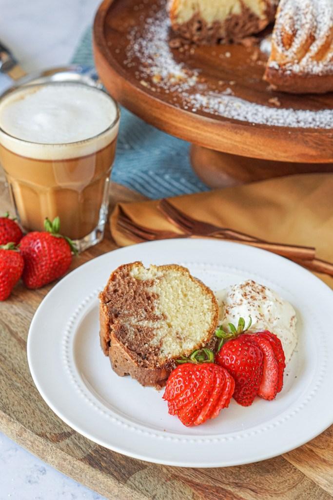 Ciambella Del Mattino (Morning Bundt Cake) on a plate with strawberries