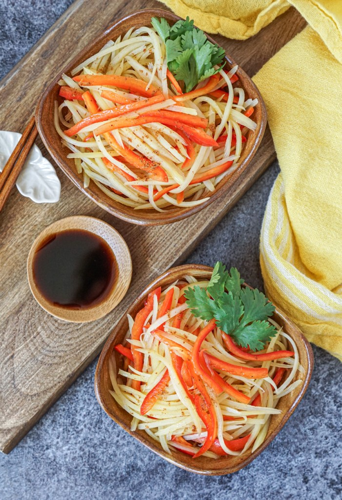 Aerial view of Shredded Potato and Red Bell Pepper with Black Vinegar