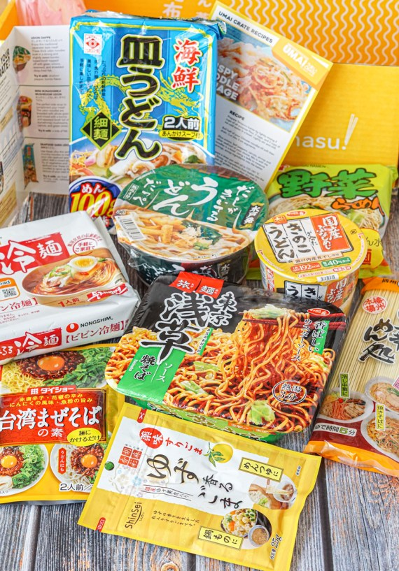Instant Noodle Packets from Umai Crate Box Review with the yellow cardboard box in the background.
