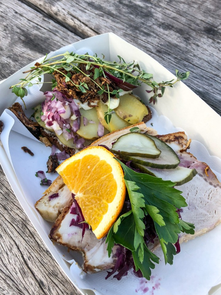 Kartoffelmad (potato, red onion, fried onion, mayonnaise, and herbs) andFlæskesteg(roast pork with crispy crackling, pickled red cabbage, and cucumber salad)