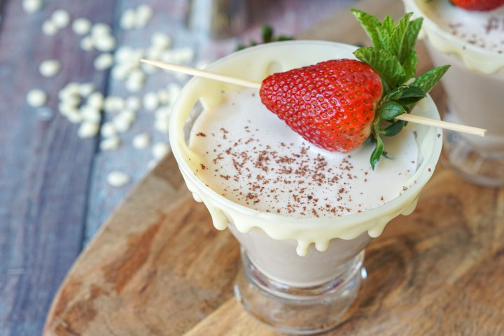 White Chocolate Espresso Martini topped with a strawberry and fresh mint.