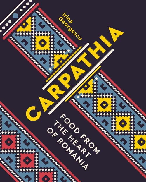 Carpathia: Food from the Heart of Romania by Irina Georgescu cookbook cover. Dark blue with diagonal red, blue, and white stripes and letters in yellow print.
