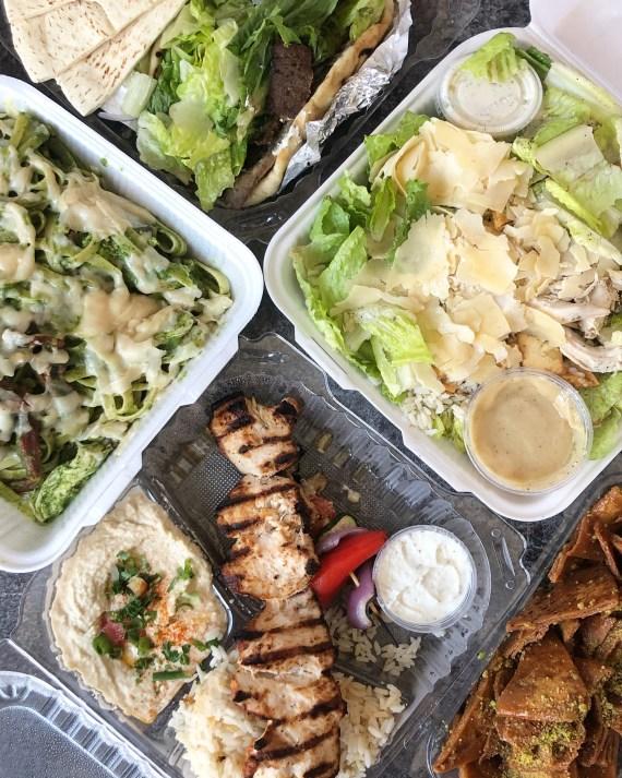 Chicken kabob, salad, pasta, and gyro wrap at Chicken Maison.