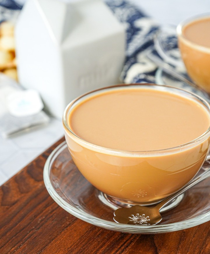 Kong Sik Nai Cha (Hong Kong-Style Milk Tea) in two glass tea cups.