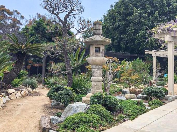 Stone lantern and palm trees at South Coast Botanic Garden.