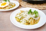 Chilaquiles Verdes on two white plates.