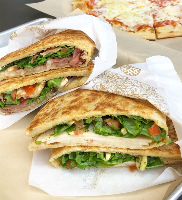 Two piadina sandwiches and a cheese pizza from Piadina.