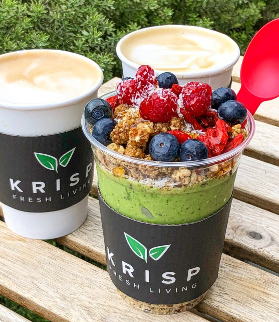 Two lattes and a green superfood bowl in a clear cup from Krisp Fresh Living.