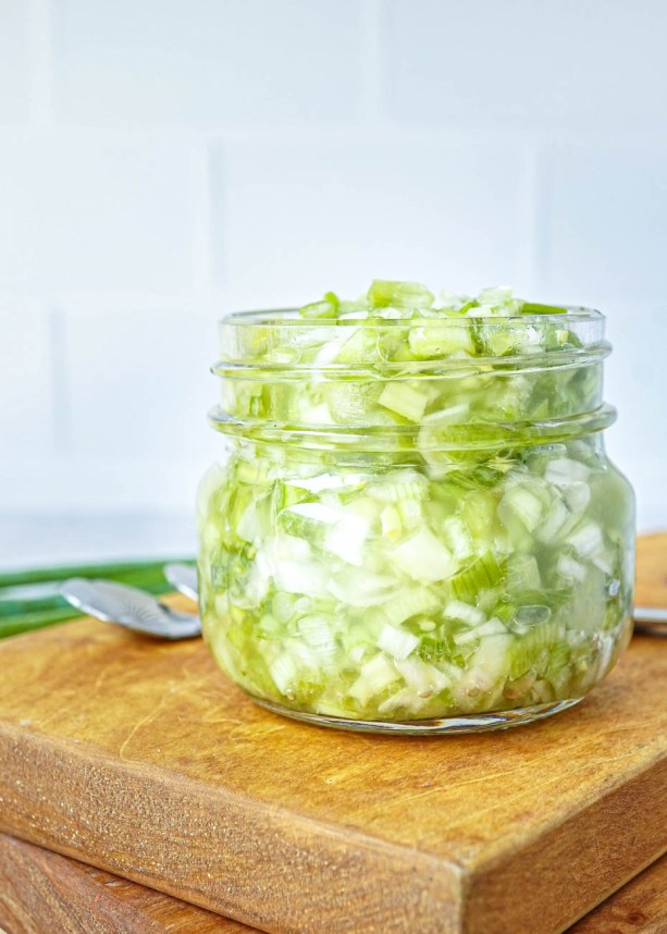 Side view of Scallion Ginger Jam in a glass jar.