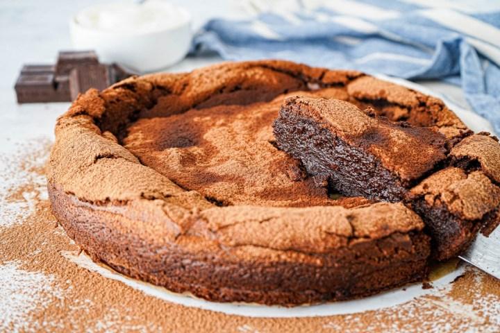 Flourless Chocolate Fudge Cake with a slice sticking up.