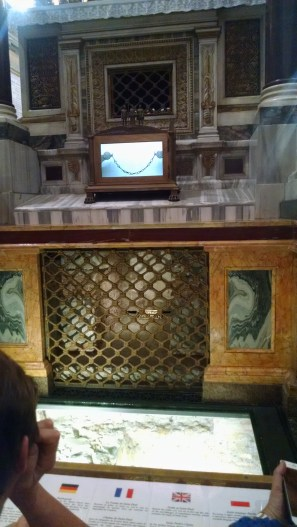 Behind the grate is the tomb of St Paul. Above is a piece of chain said to have been part of St Paul's inprisonment in Rome.