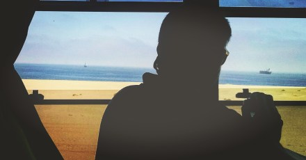 Desert meets Atlantic. Ships in the distance.