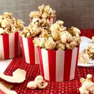 Apple cinnamon popcorn in red and white cups close up