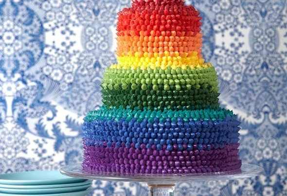 The most impressive cake you'll bake all year! It looks like it comes from a bakery, but this rainbow cake is easy to make at home!