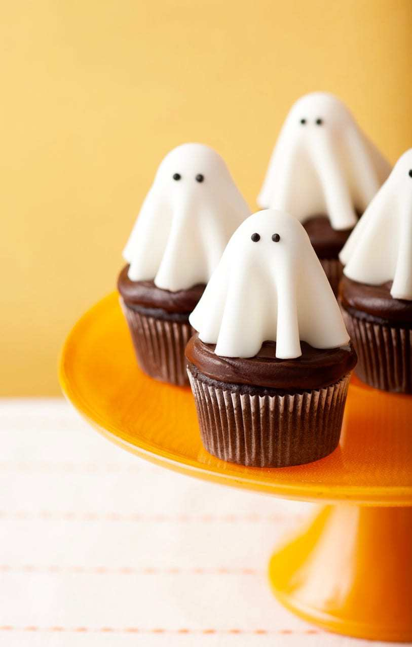 floating ghost cupcakes on yellow