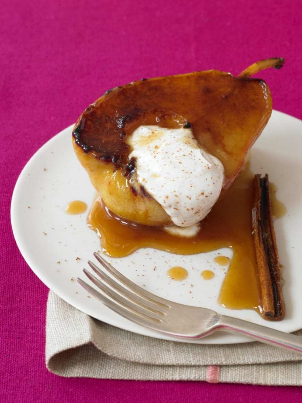 perfect pears fat free dessert with cinnamon and a pink background