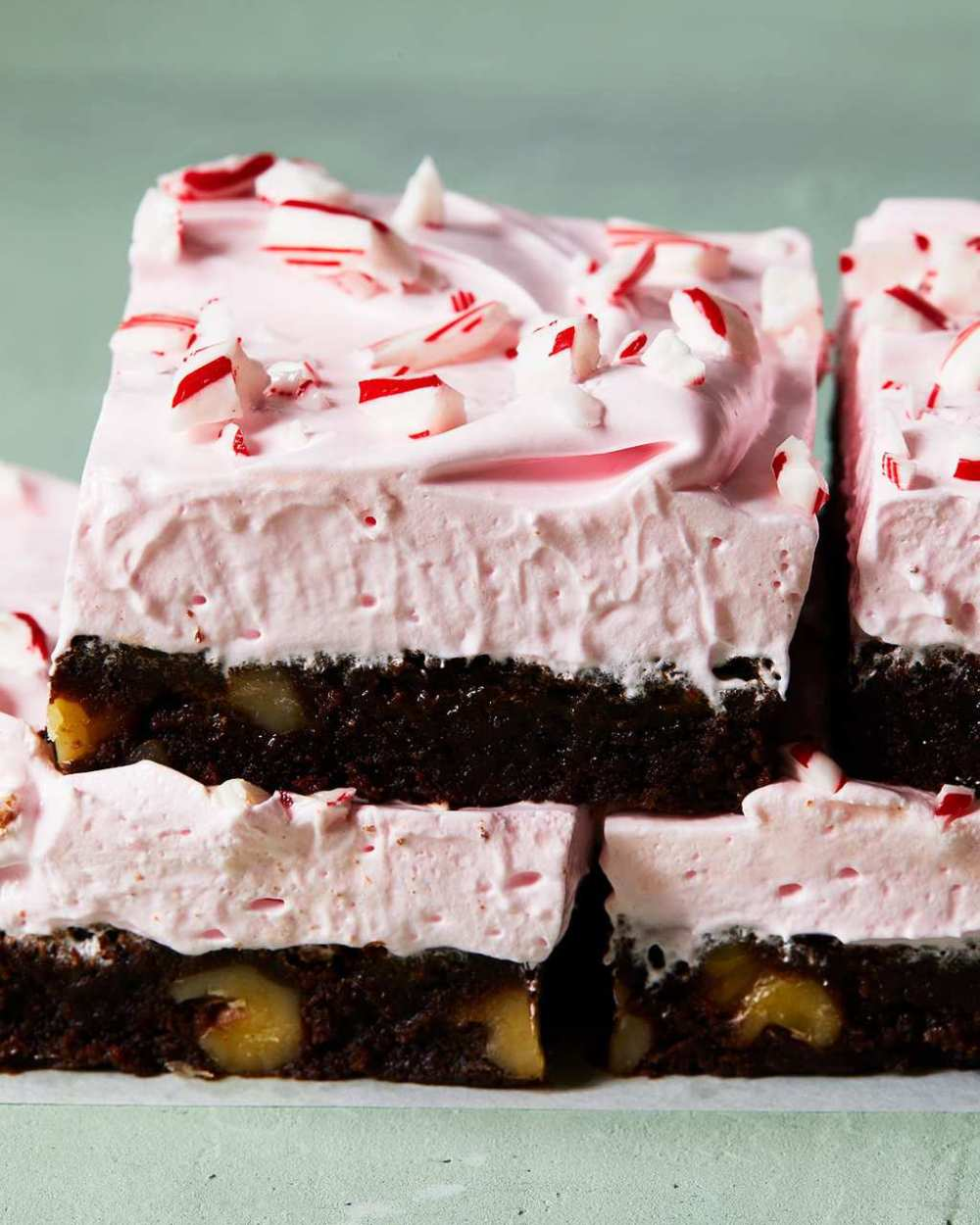 holiday peppermint brownies with pink frosting close up