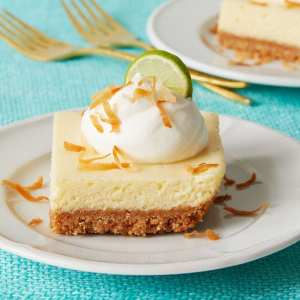 Key Lime Bars on a plate with gold forks