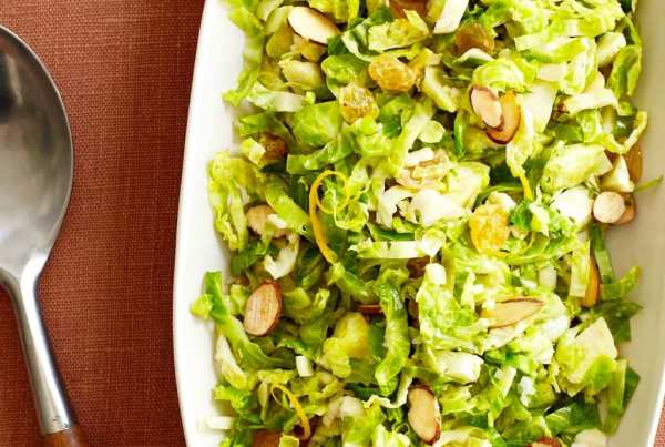 Shredded Brussels Sprouts with Orange and Almond on a linen tabletop